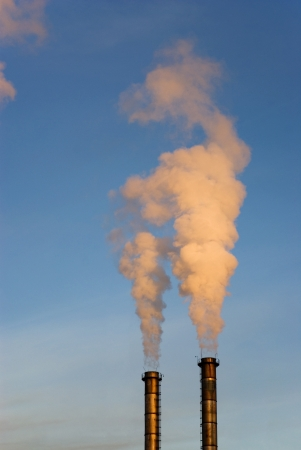 evaporate: Pollution smoke coming out of heating plant chimneys