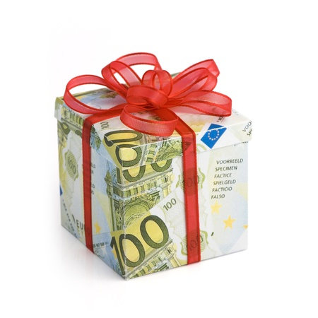 money box: A gift box covered in Euro banknotes with red colored ribbon applied Stock Photo