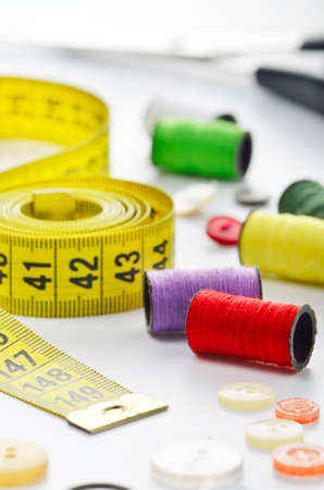 craft material tinker: Sewing accessories  tape measure, buttons, spool and scissors Stock Photo