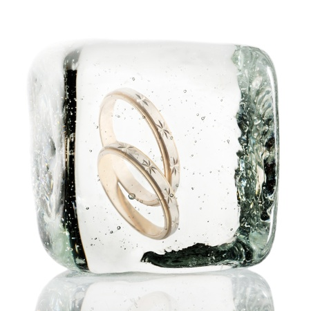 Engagement rings frozen in a block of ice photo