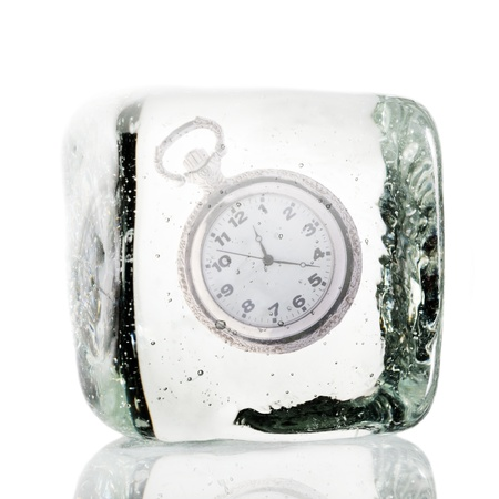 standstill: Frozen clock in a block of ice Stock Photo