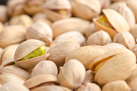 shuck: Background of roasted pistachio nuts
