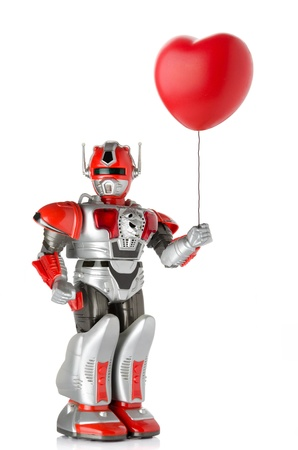 Robot toy holding red heart