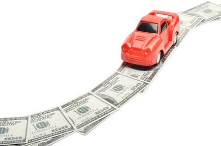 car gas: Toy car on money road isolated on white background