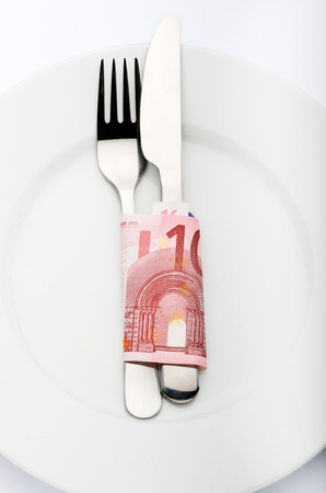 dining out: Fork and knife wrapped in 10 euro bill