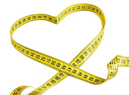 cintas metricas: La cinta de medición que forman la forma de un corazón Foto de archivo