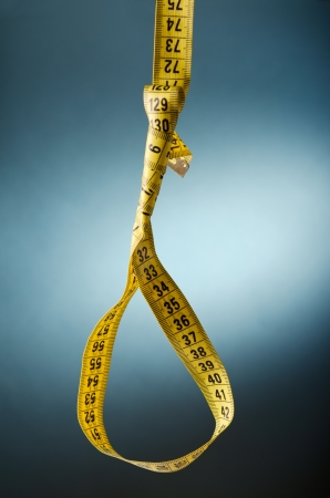 hang body: Tape measure noose on blue background
