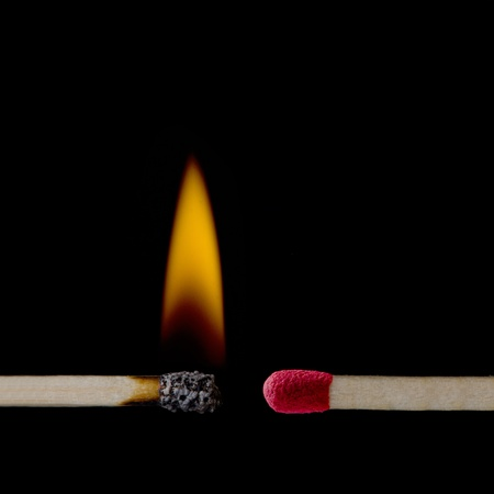 matchstick: A lit matchstick close to an unlit matchstick