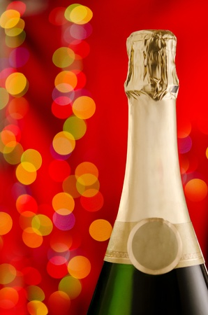 Top of a champagne bottle with celebratory background