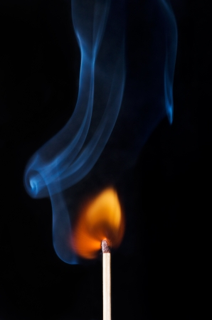 Burning Match with flame and smoke photo