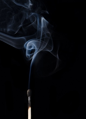 Extinguished match with smoke rising up Stock Photo - 20861572