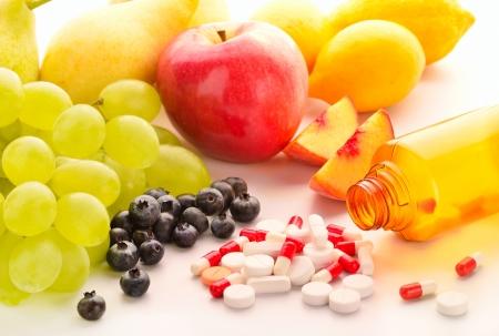 cholesterol free: Vitamin pills with fresh fruits
