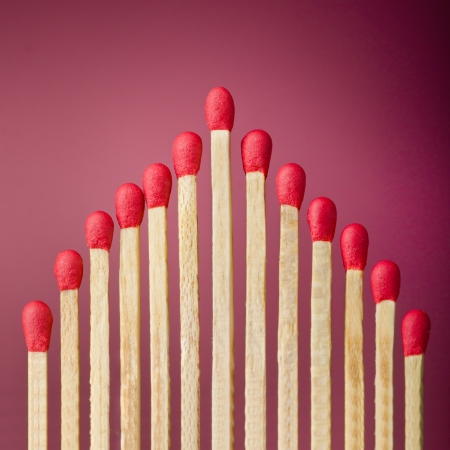 Row of unburned matches over red background Stock Photo - 20902148
