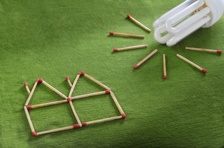 environmental issue: Energy saving setup made out of matchsticks Stock Photo