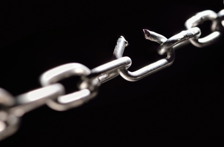Iron Chain with one link about to break photo