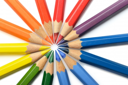 Circular arrangement of colored pencils on white background Stock Photo
