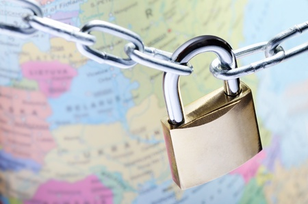 Closeup of padlock on world map representing global security concept