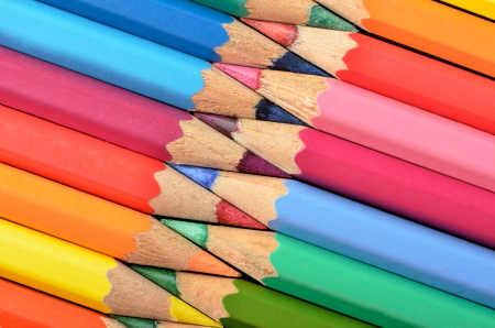 Rainbow colors with pencils arranged in the shape of a zipper