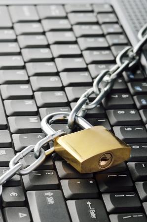 Locked chain on computer keyboard photo