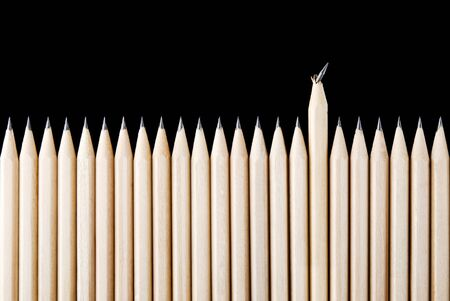 disconnection: One broken pencil standing out from the row Stock Photo