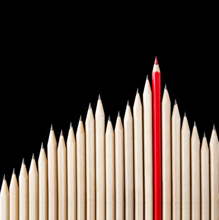 nonconformity: One red pencil standing out from the row