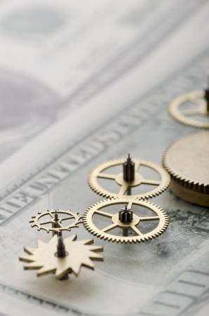 Gear of success Gear wheels on dollar bill revealing the path to success Stock fotó