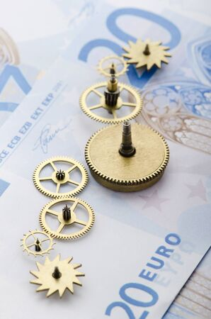 european union currency: Gear of success  Gear wheels on Euro note revealing the path to success Stock Photo
