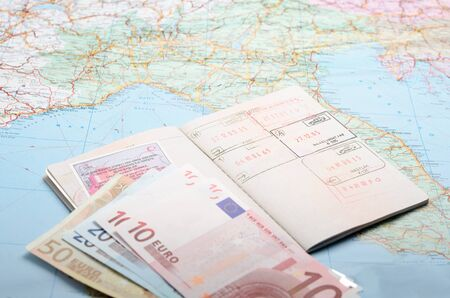 european union currency: Passports and money over map background