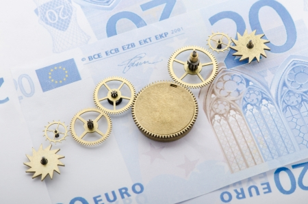 economic growth: Gear of success  Gear wheels on Euro note revealing the path to success Stock Photo