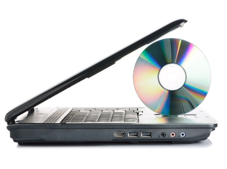 Laptop and data disc on white background photo
