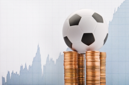 Soccer ball on a financial report background Stock Photo