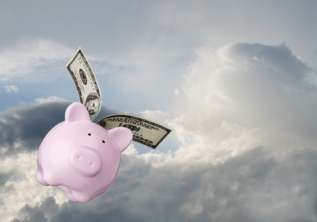 pig wings: Piggy bank flying free in sky Stock Photo