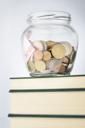 pennypinching: A jar of coins with savings for education