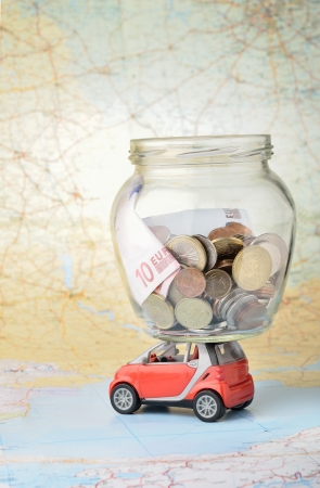 pennypinching: A jar of coins with savings for vacation
