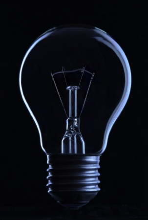 filament: Light bulb on black background Stock Photo