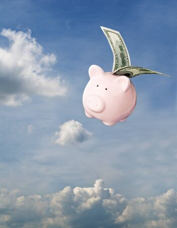 Piggy bank flying free in Sky photo