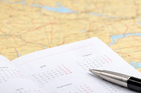 reminding: Vacation planning with map, pen and agenda Stock Photo