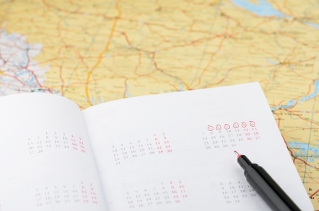 accomodation: Vacation planning with map, marker and agenda