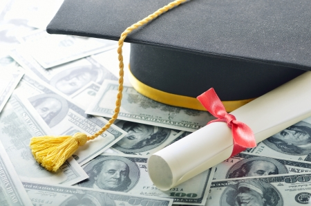 loans: Graduation hat with diploma and money
