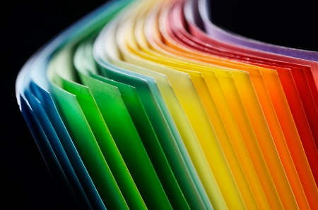 elliptical: Colorful paper section in elliptical shapes on black background