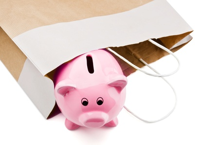 Piggy bank in a shopping bag photo