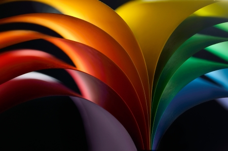 colored paper: Rainbow colored paper on black background