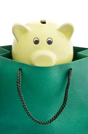 Piggy bank in a shopping bag Stock Photo - 20932018