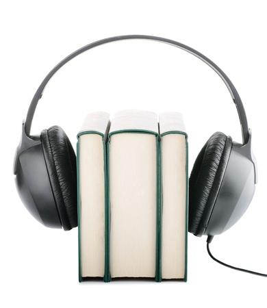 suggesting: Headphones around books suggesting listening to books instead of reading them Stock Photo