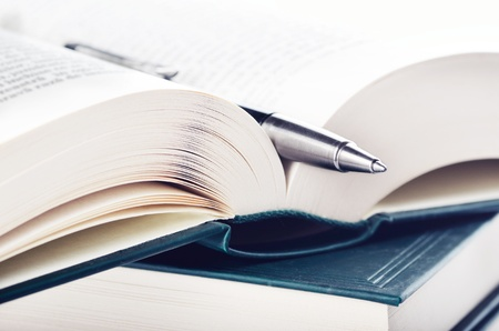 bestseller: Close-up of open book and pen Stock Photo