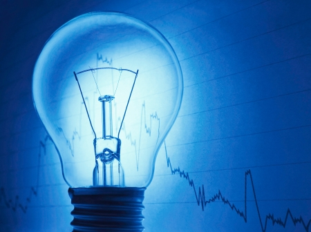 financial figure: Bulb with business background showing concept of a successful  idea