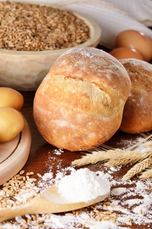 Rural scene of homemade bread with potatoes and eggs photo