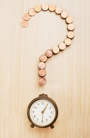 Question mark sign made out of coins and alarm clock Stock Photo - 20948752