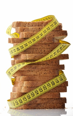 tapeline: Measuring tape wrapped around stack of slices of bread Stock Photo