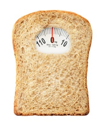self indulgence: Weighing scales in form of a bread slice representing dietary warning
